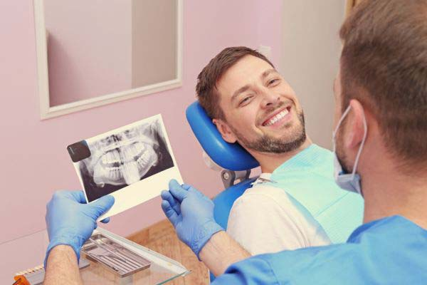 Reasons To Replace Your Dentures With Dental Implants