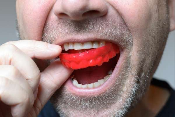 Save Your Teeth By Wearing Mouth Guards At Night